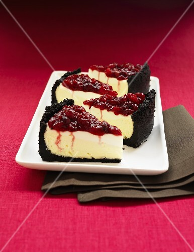 Cheese cake with sour cream, chocolate crust and cherry topping