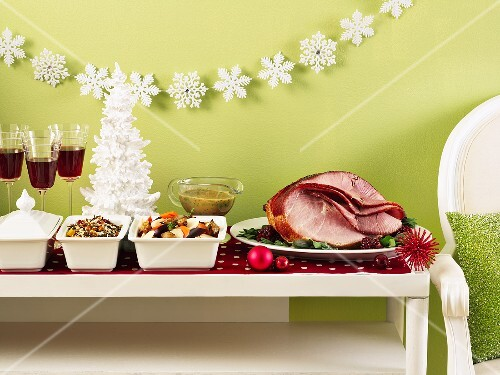 Christmas buffet table with roast ham, vegetables and rice