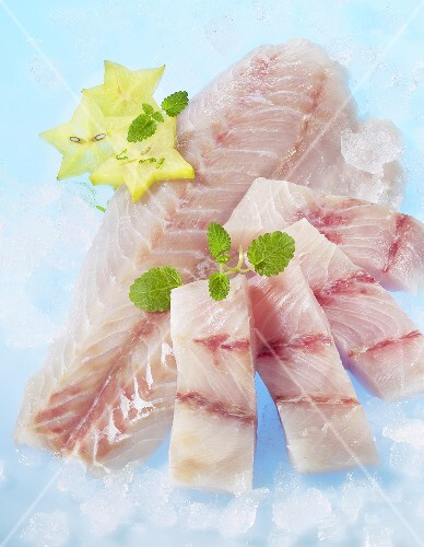 Fresh Victoria perch fillets with lemon balm and star fruit