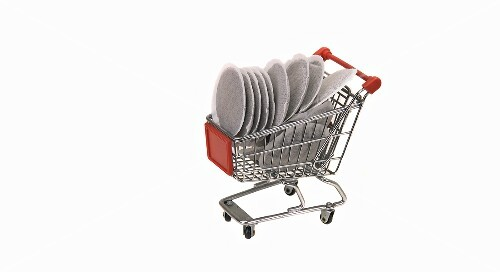 A model shopping trolley filled with coffee pads
