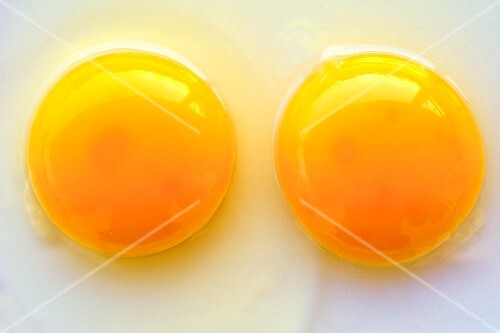 Two egg yolks, seen from above