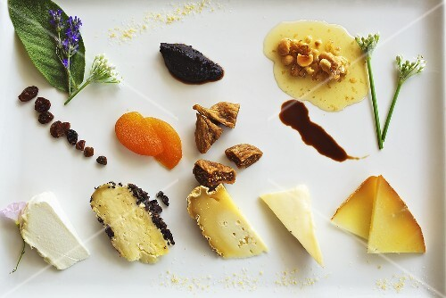 A cheese plate of dried fruit in a restaurant (Piemont, Italy)