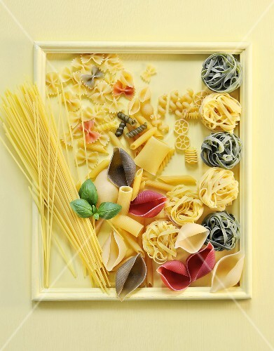 Various types of pasta in a picture frame