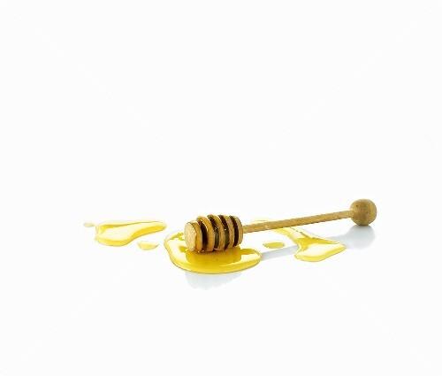 Honey with honey dipper