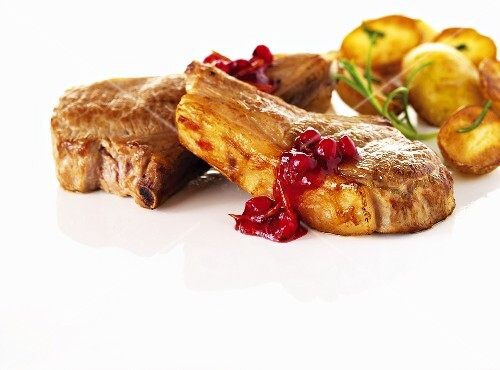 Lamb chops with cranberries and roast potatoes