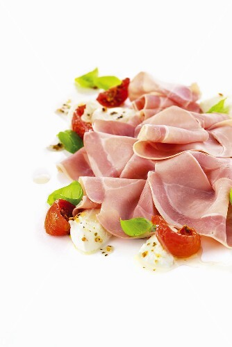 Boiled Parma ham with mozzarella and tomatoes