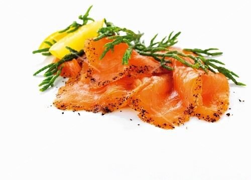 Slices of smoked salmon with glasswort