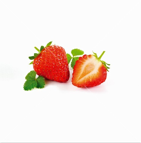 A whole strawberry and half a strawberry