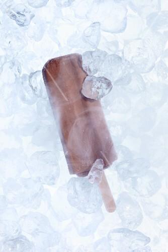 Chocolate ice cream between ice cubes