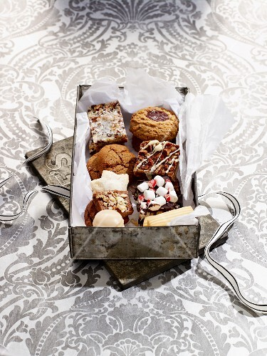 Various Christmas biscuits in a biscuit tin