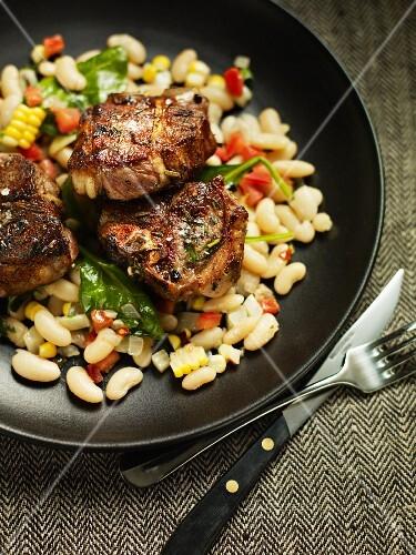 Lamb chops on a bean and corn salad