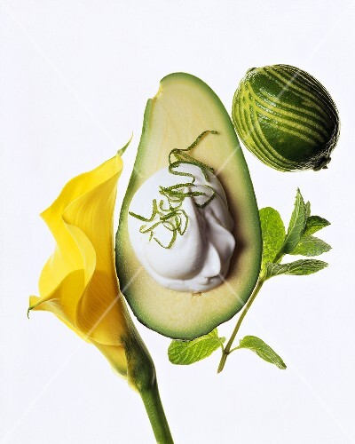 An avocado with sour cream and lime zest