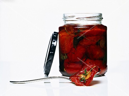 A jar of dried tomatoes in oil