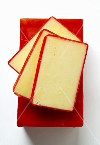 Three slices of Vermont Cheddar on a cheese