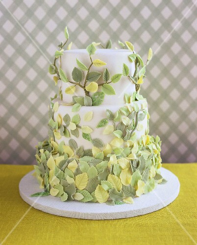Wedding cake with springtime decoration of sugar leaves