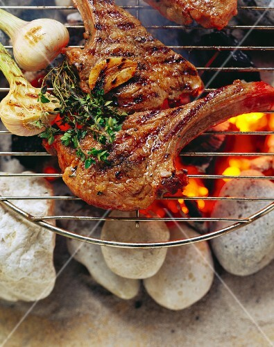 Lamb cutlets with tandoori buttermilk marinade on barbecue
