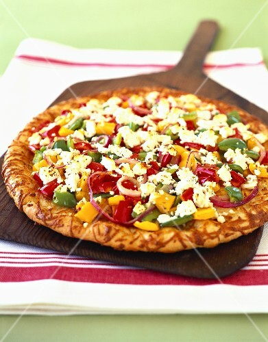 Pizza with vegetables and feta