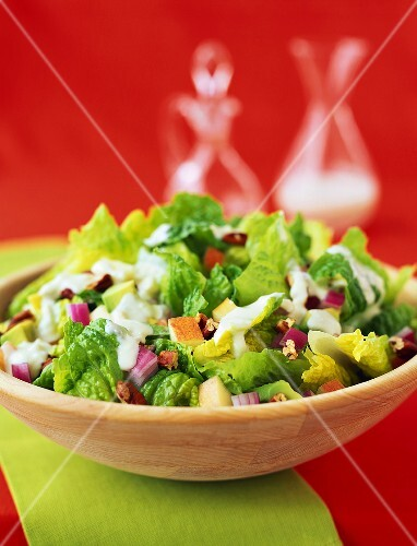 Romaine lettuce with pieces of apple and cheese