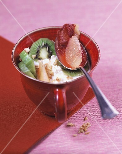 Fruit salad on grainy yoghurt cream