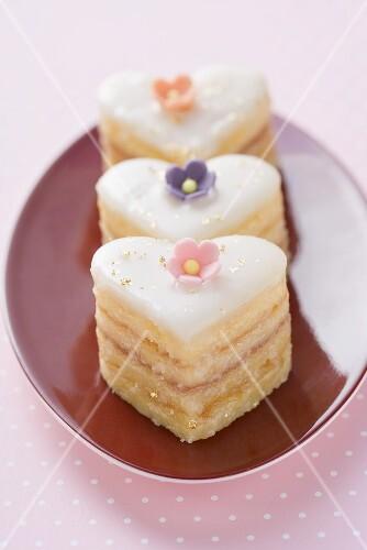 Three small heart-shaped cakes