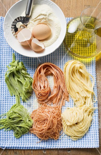 Various types of home-made pasta with ingredients