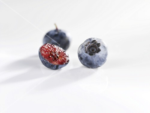 Blueberries, one halved