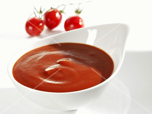 Tomato ketchup in white dish