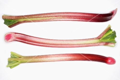 Three sticks of rhubarb side by side