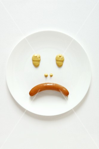 Frankfurter and mustard making a sad face