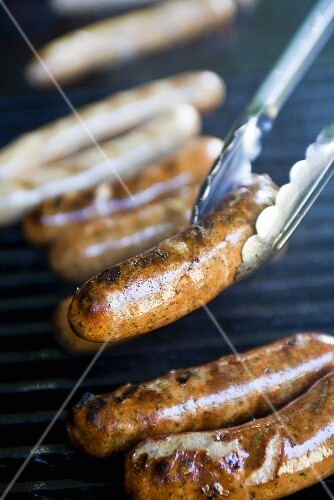 Sausages on a barbecue (close-up)