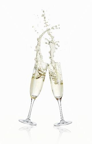 Glasses of sparkling wine clinking together