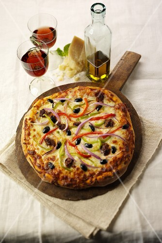 Sausage and Vegetable Pizza on Wooden Wheel with Wine