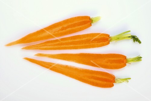 Four slices of carrot with tops