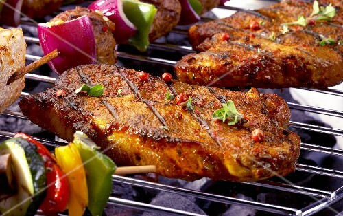 Pork steaks on barbecue