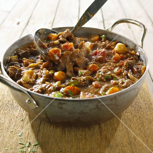 Beef stew in pot with ladle