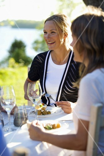 Two women at a mid-summer party (Sweden)