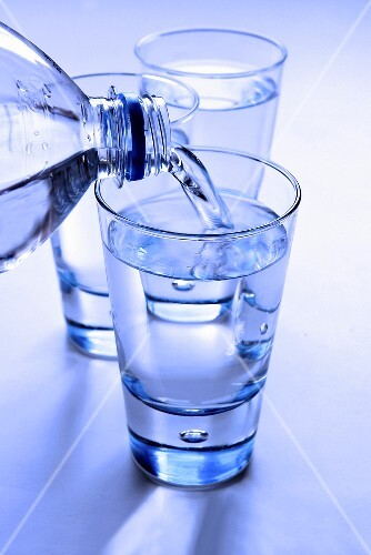 Pouring a glass of mineral water