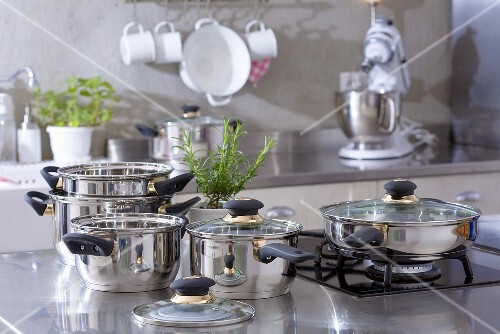 Assorted stainless steel pans in a kitchen