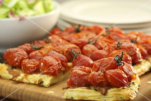 Puff pastry tart with cherry tomatoes and cheese