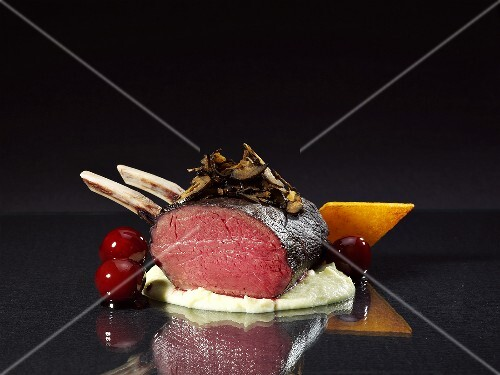 Venison with gingerbread sauce and candided cherries