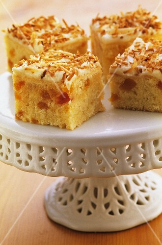 Apricot and coconut slices on a cake stand