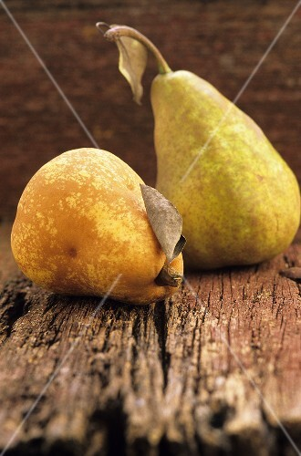 Two pears on a wooden surface