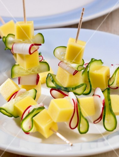 Cheese, cucumber and radishes on cocktail sticks