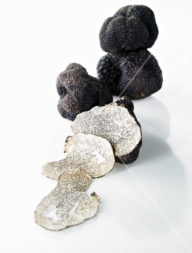 Black truffles, whole and partly sliced