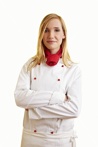 Blond female chef in work clothes