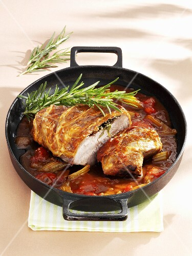 Roast veal with rosemary in a vegetable sauce