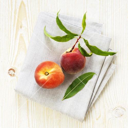 Organic peaches on linen cloth