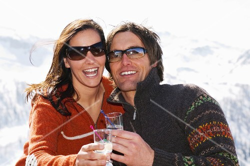 Couple having drink in mountains