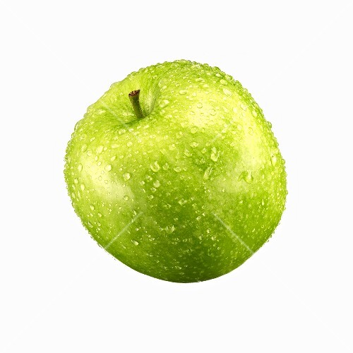 Green apple with drops of water