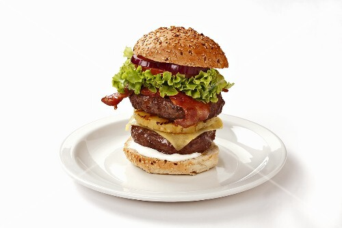 Double-decker burger with bacon and pineapple
